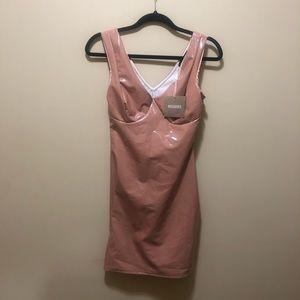 Pink vinyl dress brand new